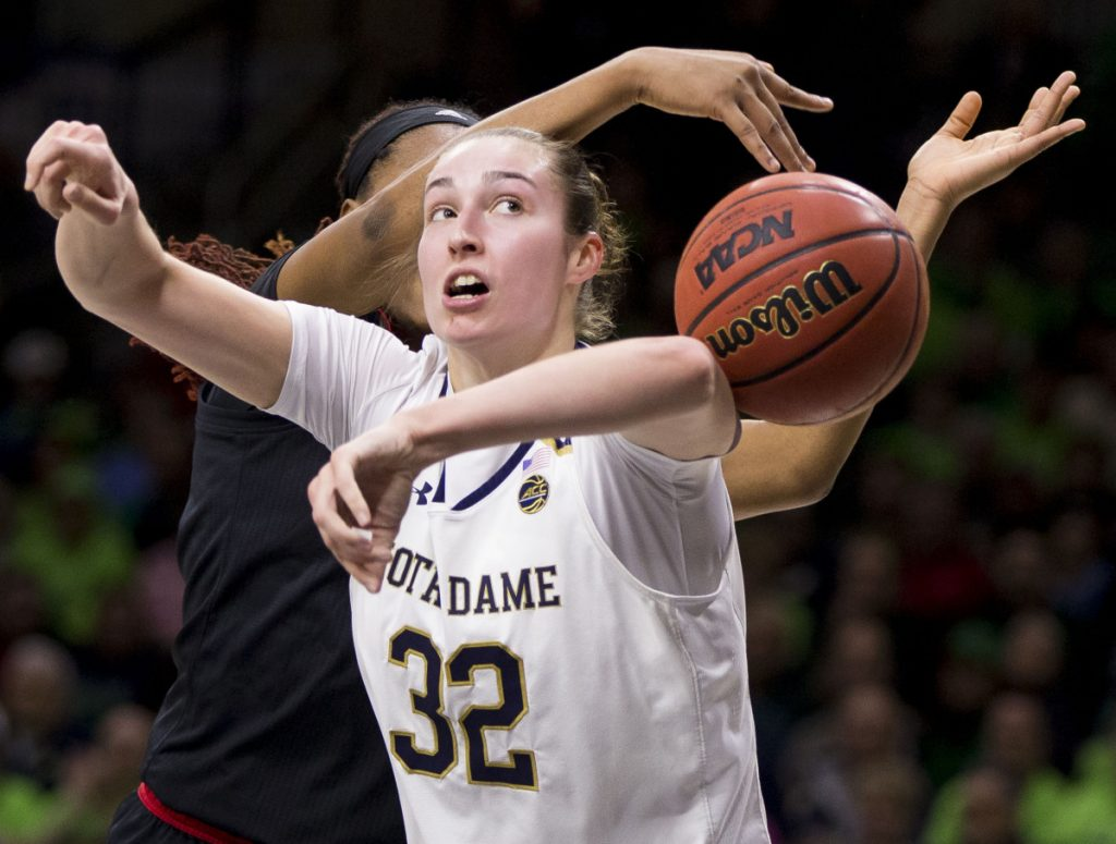 Jessica Shepard of Notre Dame has the ball knocked away by Bionca Dunham of Louisville the first half of Notre Dame's 82-68 victory Thursday night.