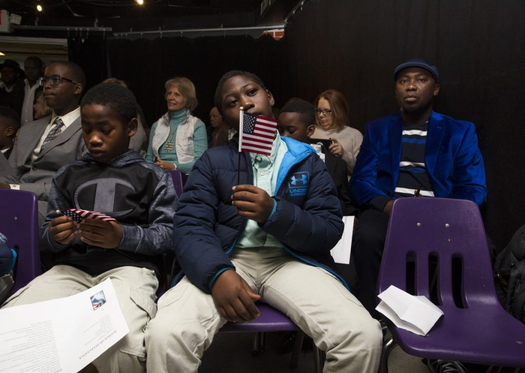 Mortada Abdalla, 9, right, and his brother Maaz Abdalla, 7, after taking the Oath of Allegiance. The boys, originally from Sudan, were two of four siblings who became citizens.
