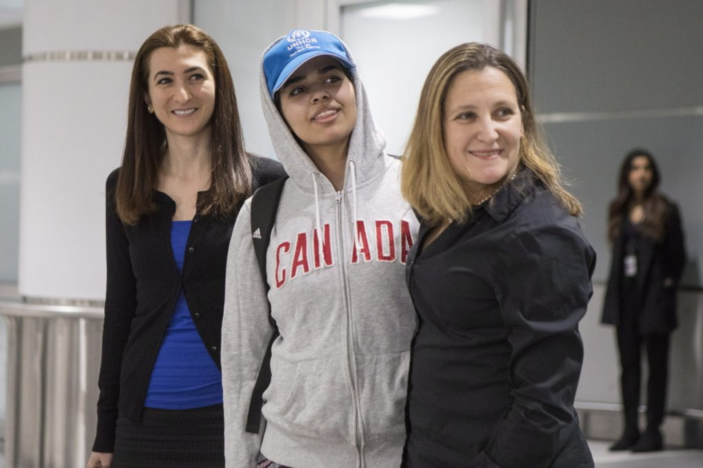 Rahaf Mohammed Alqunun, 18, center, stands with Canadian Minister of Foreign Affairs Chrystia Freeland, right, as she arrives in Toronto on Saturday. Other countries were in talks to provide refuge but the Saudi teen chose Canada.