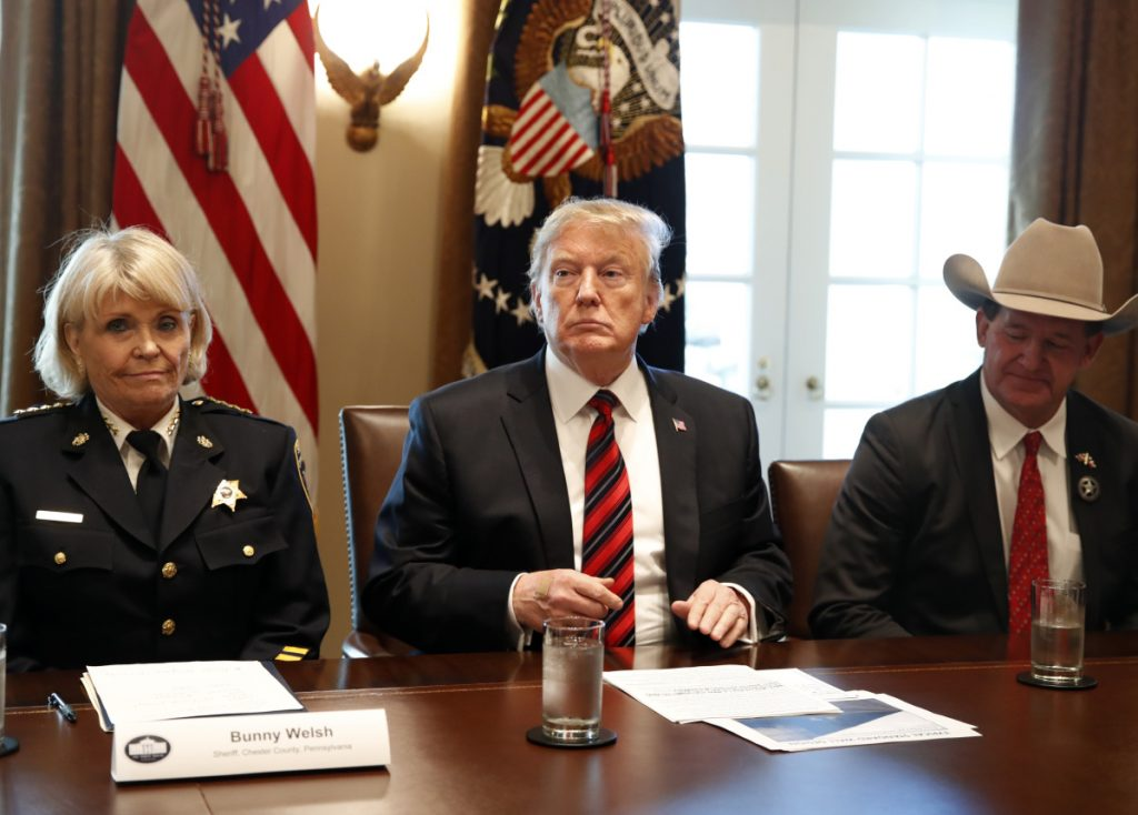 "President Trump, with Carolyn ""Bunny"" Welsh, sheriff of Chester County, Pa., left, and A.J. Louderback, sheriff of Jackson County, Texas, attends a roundtable discussion on border security with local leaders Friday."