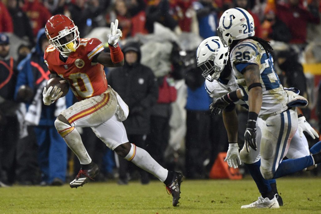Kansas City wide receiver Tyreek Hill gestures as he runs past Indianapolis safety Clayton Geathers and linebacker Anthony Walker during the second half of the Chiefs' 31-13 win in the AFC divisional round on Saturday in Kansas City, Missouri.