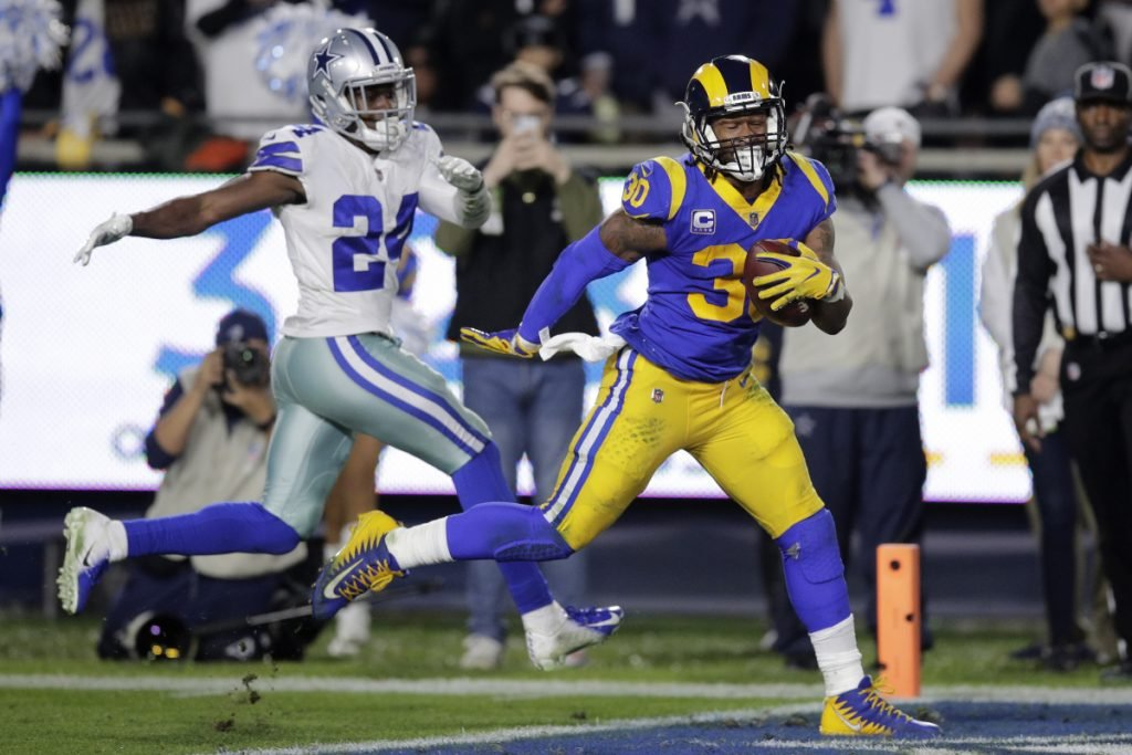 Rams running back Todd Gurley outraces Cowboys cornerback Chidobe Awuzie for a touchdown Saturday night in an NFC divisional-round game. The Rams won, 30-22.