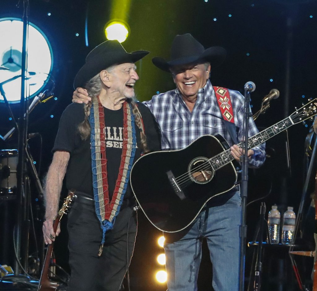 "Willie Nelson, left, and George Strait perform at ""Willie: Life & Songs Of An American Outlaw"" at Bridgestone Arena on Saturday in Nashville, Tenn."