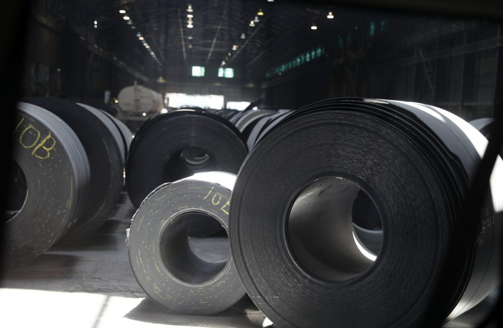 Rolls of finished steel sit on the floor of a facility in Granite City, Ill. President Trump's steel tariffs have raised metals prices in the United States, putting financial pressure on manufacturers who use steel in their production process.