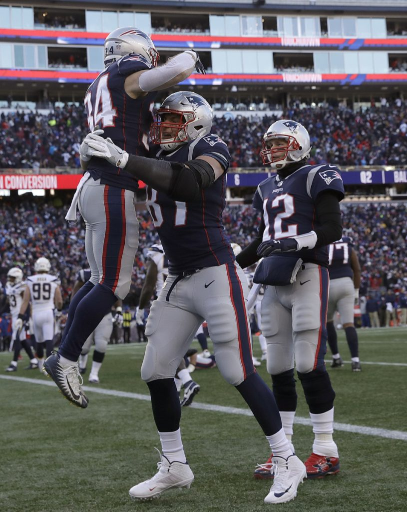 Rex Burkhead receives a lift from Rob Gronkowski after scoring in the first half of the Patriots' 41-28 victory Sunday against the Los Angeles Chargers.
