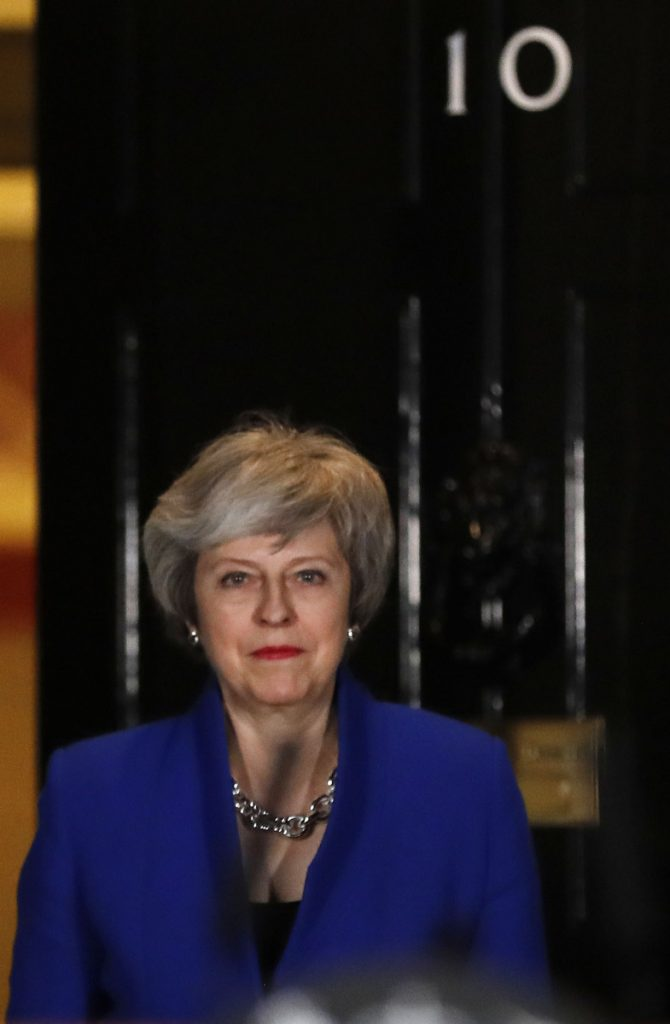 British Prime Minister Theresa May arrives Wednesday to speak outside 10 Downing St.