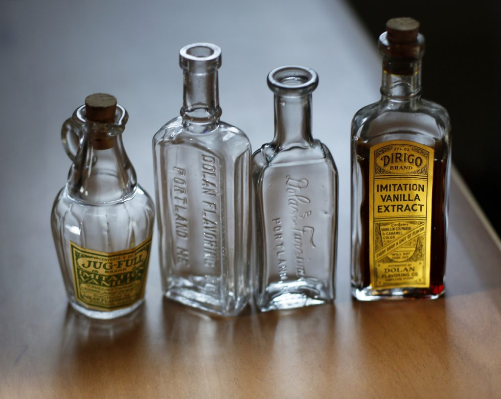 Vintage vanilla bottles from Dolan Flavoring Co., one of Maine's oldest surviving businesses.