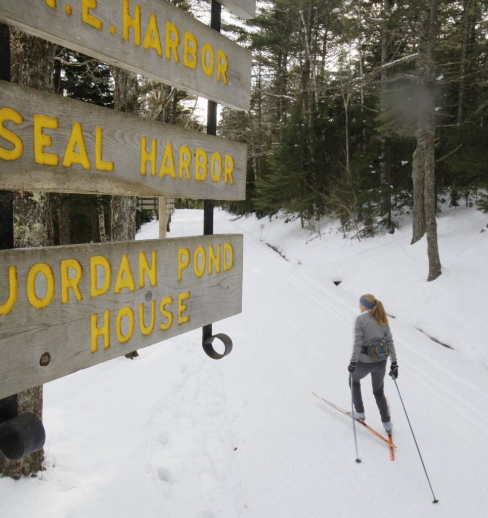 Abigail Curliss of Southwest Harbor skis beside Eagle Lake on a carriage road at Acadia National Park on Mount Desert Island. Curliss has worked as a volunteer trail groomer.