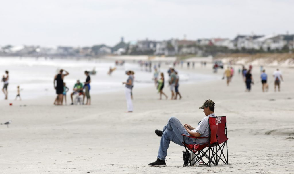 Beach goers hang out at the Isle of Palms, S.C., as Hurricane Florence spins out in the Atlantic ocean in September 2018. South Carolina Gov. Henry McMaster and Attorney General Alan Wilson, both Republicans, have been working on their state's response to the Trump administration's announcement of a five-year plan to open 90 percent of the nation's offshore reserves to private development.