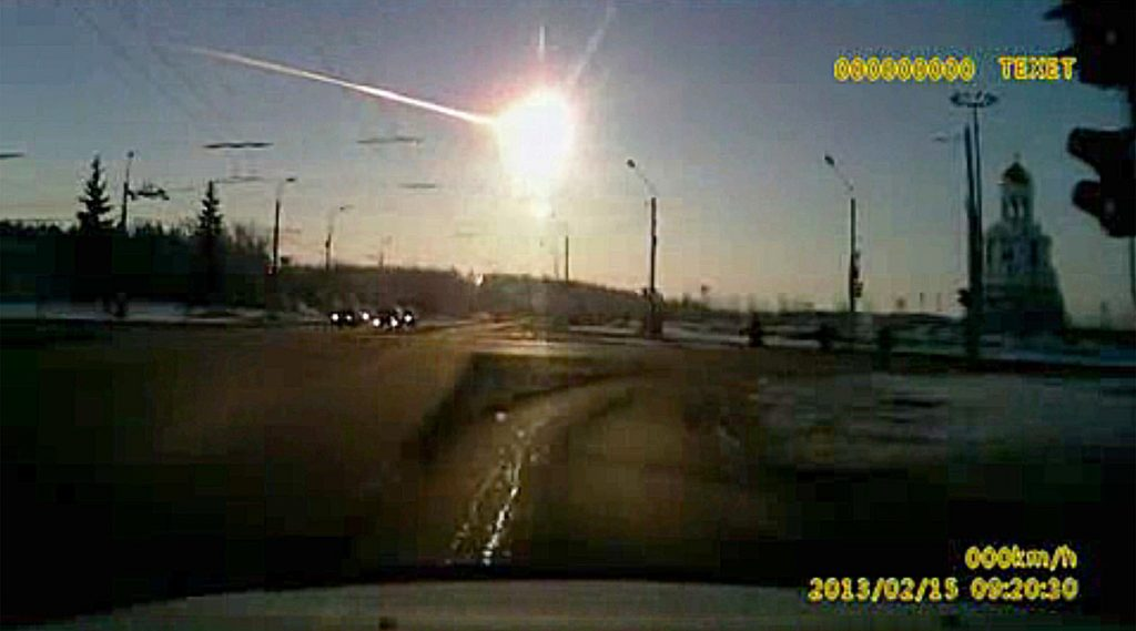 A dashboard camera catches a meteor over Chelyabinsk, Russia, in 2013. The space rock made headlines but caused only minor injuries and broke some windows. More serious events caused by larger objects such as asteroids are hitting Earth more frequently, but are still extremely rare.