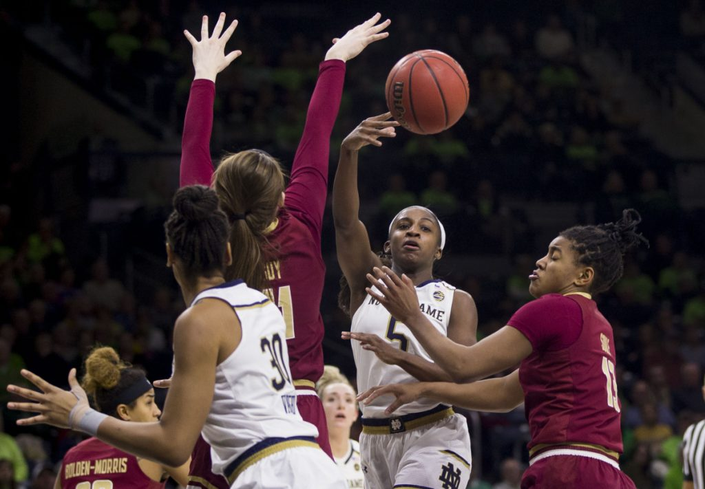 Jackie Young of Notre Dame passes the ball between Emma Guy, left, and Taylor Soule of Boston College in the second half of Notre Dame's 92-63 win Sunday.