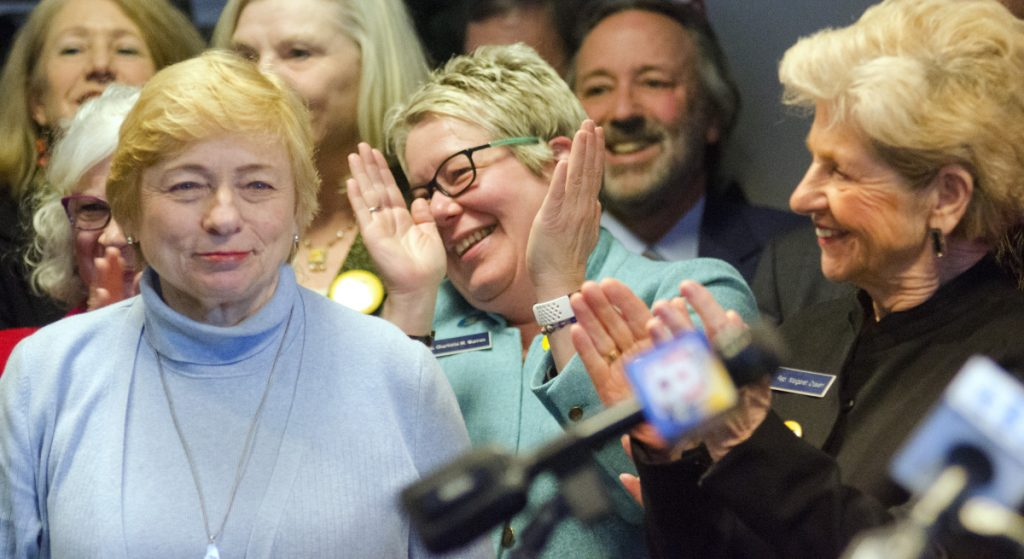 Gov. Janet Mills is applauded by Rep. Charlotte Warren, D-Hallowell, and Rep. Margaret Craven, D-Lewiston, at start of a State House news conference Tuesday, the 46th anniversary of the Roe v. Wade Supreme Court decision legalizing abortion.