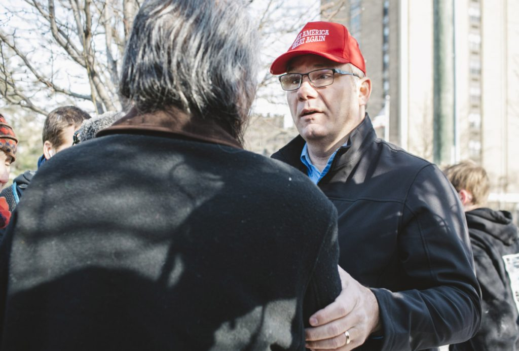 Trump supporter Don Wegman, right, approaches Guy Jones, a Native American at a protest outside the Covington Catholic Diocese in Covington, Kentucky, on Tuesday. The two exchanged phone numbers in the hope of meeting to discuss mending relations.