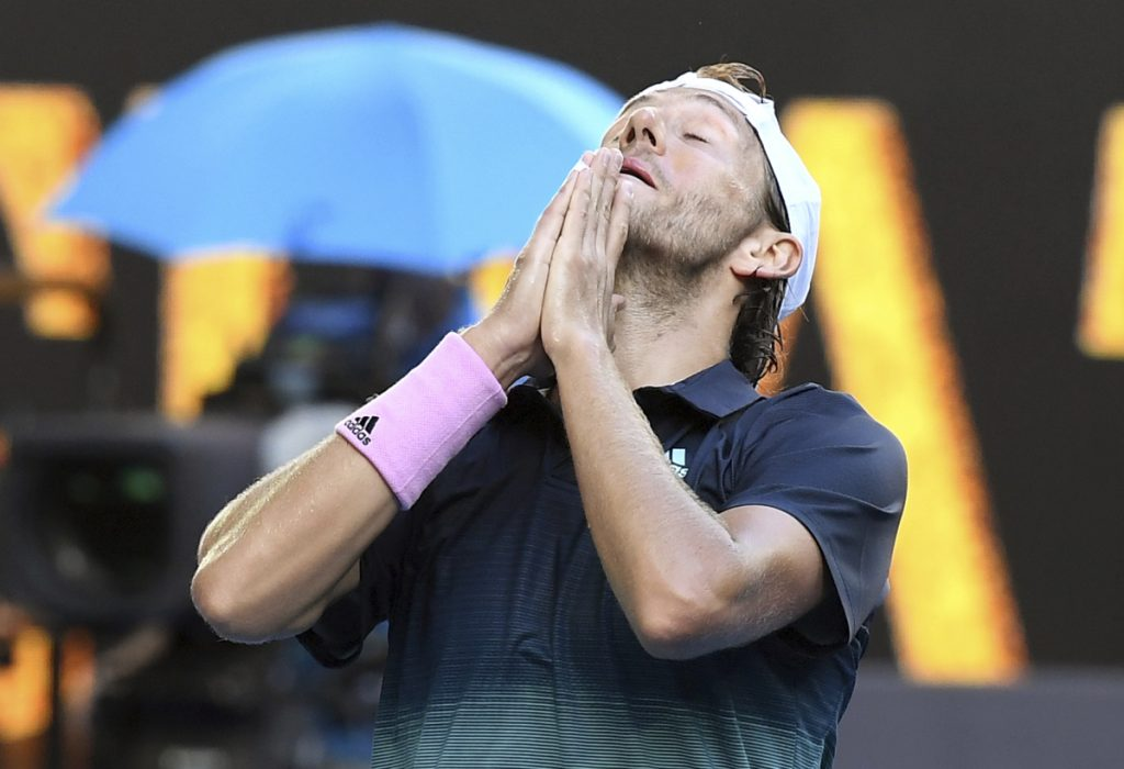 France's Lucas Pouille celebrates after defeating Canada's Milos Raonic in their quarterfinal match at the Australian Open in Melbourne, Australia on Wednesday.