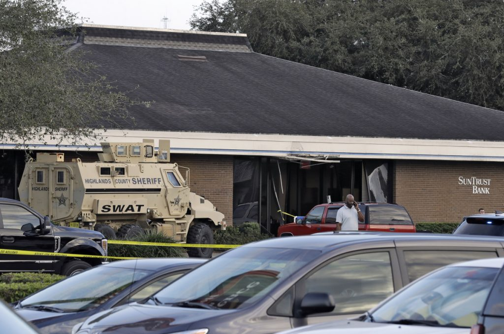 A Highlands County Sheriff's SWAT vehicle is stationed in front of a SunTrust Bank branch Wednesday in Sebring, Fla., where authorities say five people were shot and killed.