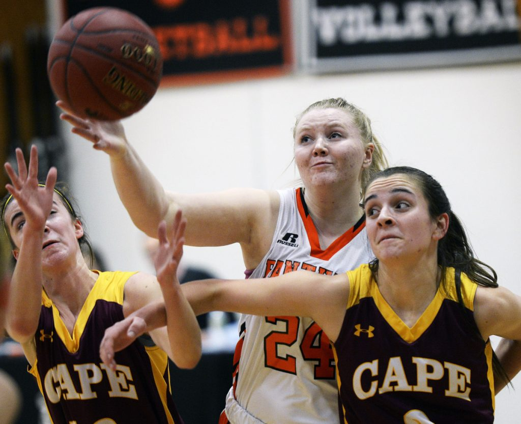 Sydney Plummer, center, of North Yarmouth Academy battles for a rebound with Cape Elizabeth's Brooke Harvey, left, and Alison Ingalls during NYA's 50-45 girls' basketball win Wednesday.