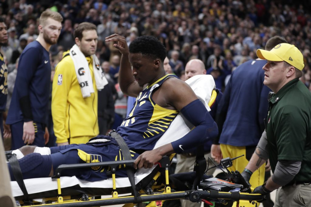 Pacers guard Victor Oladipo is taken off the court on a stretcher after went down with a right knee injury Wednesday night against Toronto.