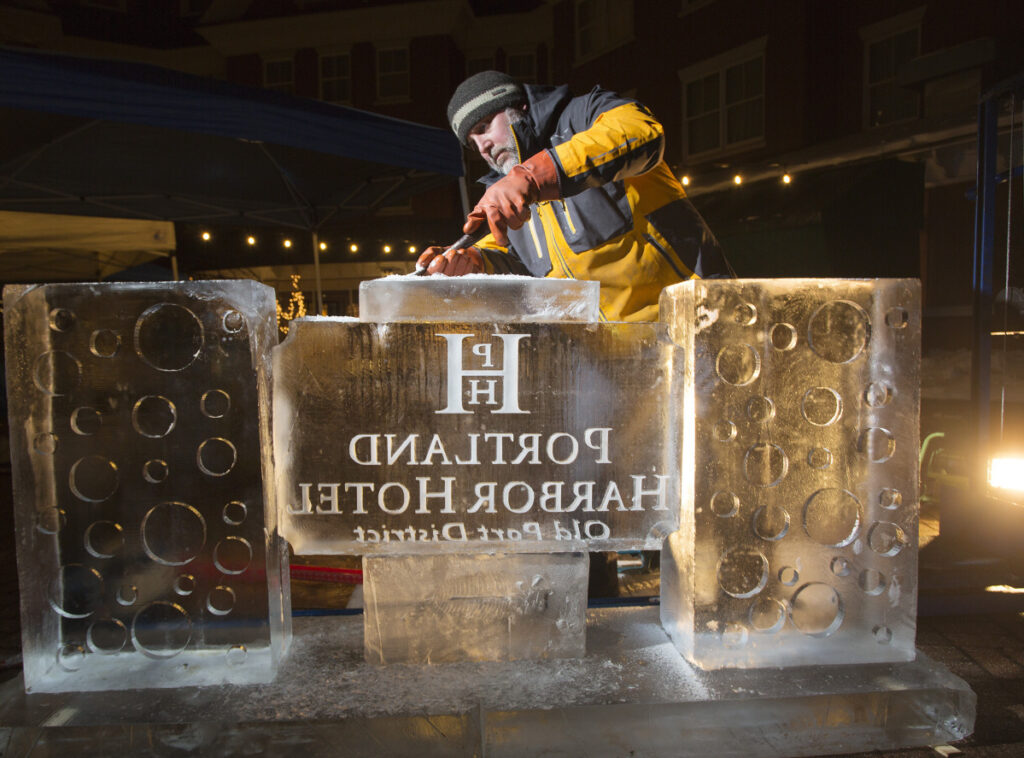Jeff Day, of Ice Designs, works on an ice bar Wednesday for Portland Harbor Hotel's annual ICEBAR weekend.