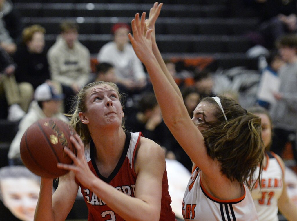 Paige Cote of Sanford prepares to shoot Friday night while guarded by Grace Martin of Biddeford during Sanford's 48-45 victory in an SMAA game on the road.