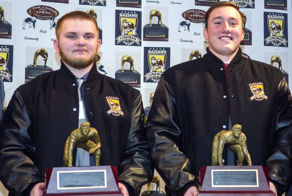 Offensive lineman Aidan McGlone of Bonny Eagle, left, and defensive lineman Thomas Palmer of Thornton Academy hold Frank Gaziano Awards on Saturday at the Augusta Civic Center.
