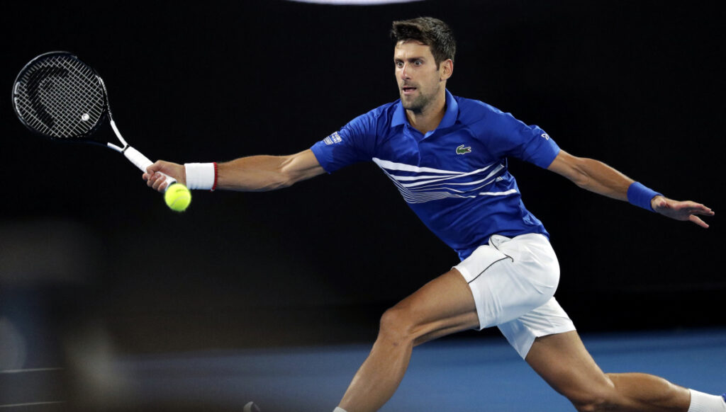 Serbia's Novak Djokovic makes a forehand return to Spain's Rafael Nadal during the men's singles final at the Australian Open tennis championships on Sunday.