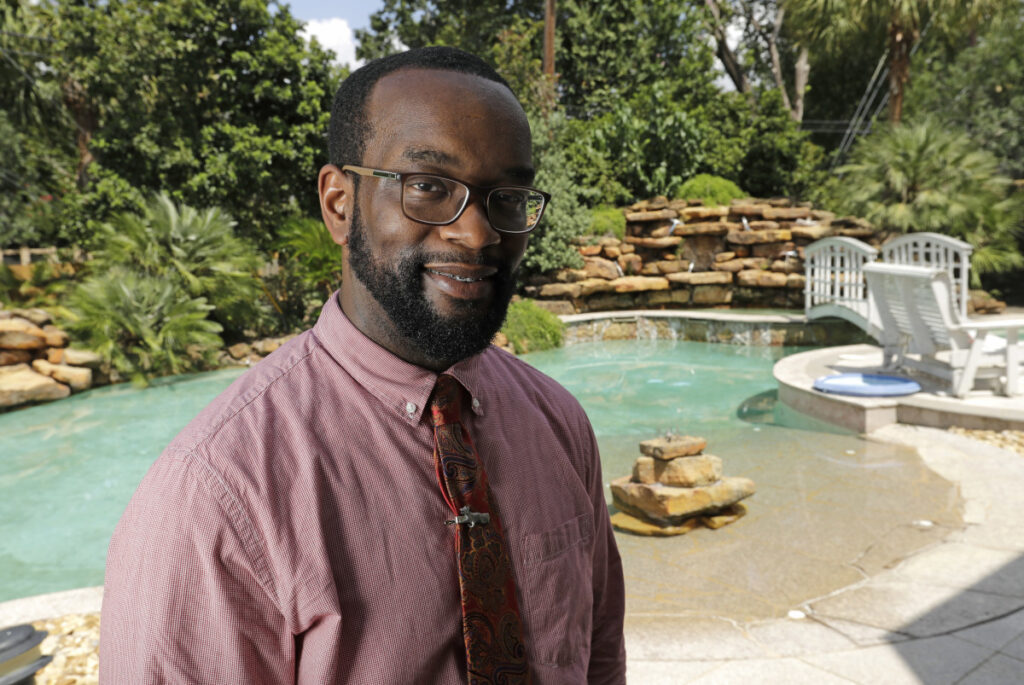 Marcus Harris, a physician in the Houston area, felt confident that he would be able to handle a severe market downturn. Associated Press/David J. Phillip