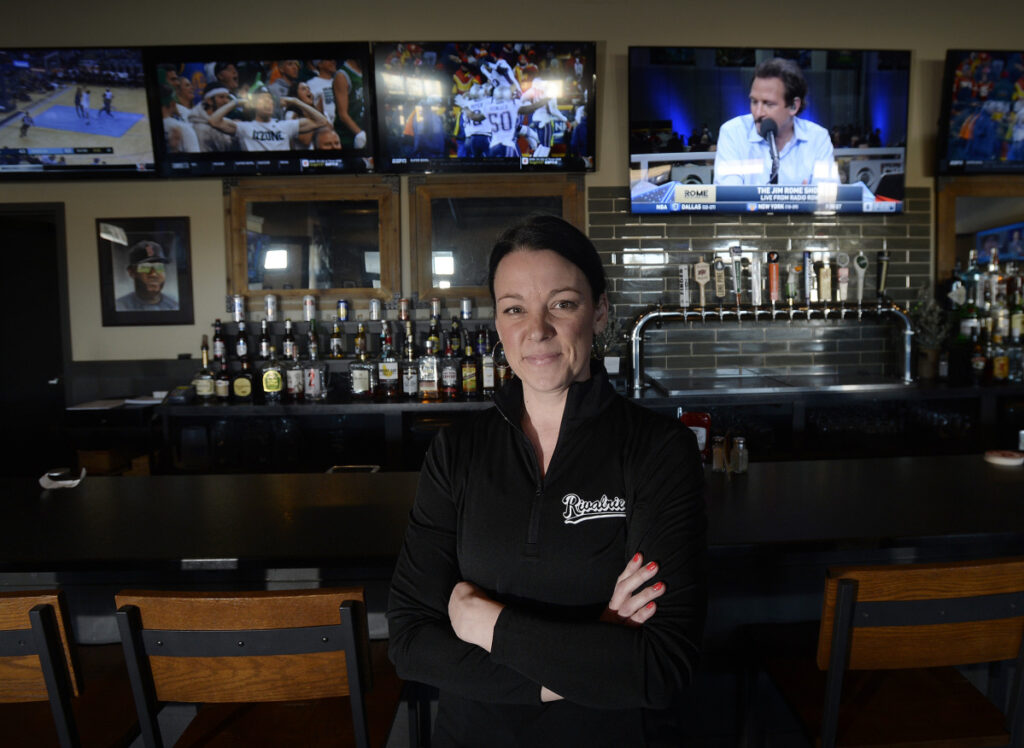 """Jen Meader, who manages Rivalries locations in Falmouth, above, and Portland, says game time Sunday at the local sports bars """"will be crazy busy."""""""