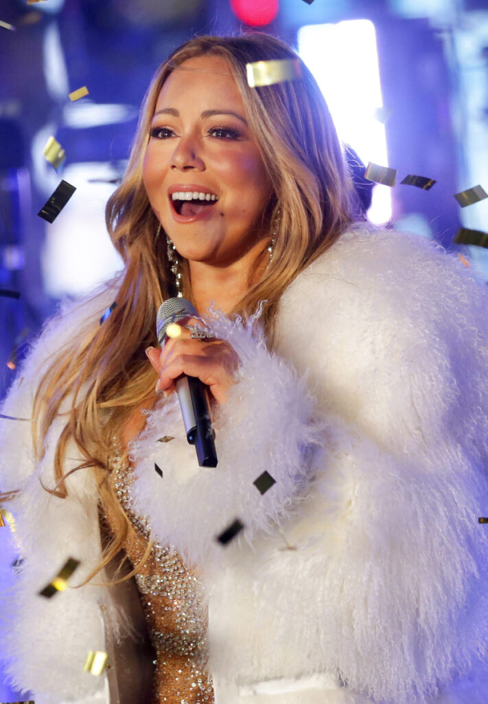 In this Dec. 31, 2017 file photo, Mariah Carey performs at the New Year's Eve celebration in Times Square in New York. Carey, one of the world's most celebrated artists, is performing in Saudi Arabia for the first time, but there's a growing chorus of Saudi women calling on her to cancel the concert in support of detained women's rights activists. Activists say her concert is an attempt by the government to polish its image after the Oct. 2 killing of Saudi critic Jamal Khashoggi inside the Saudi Consulate in Istanbul. (