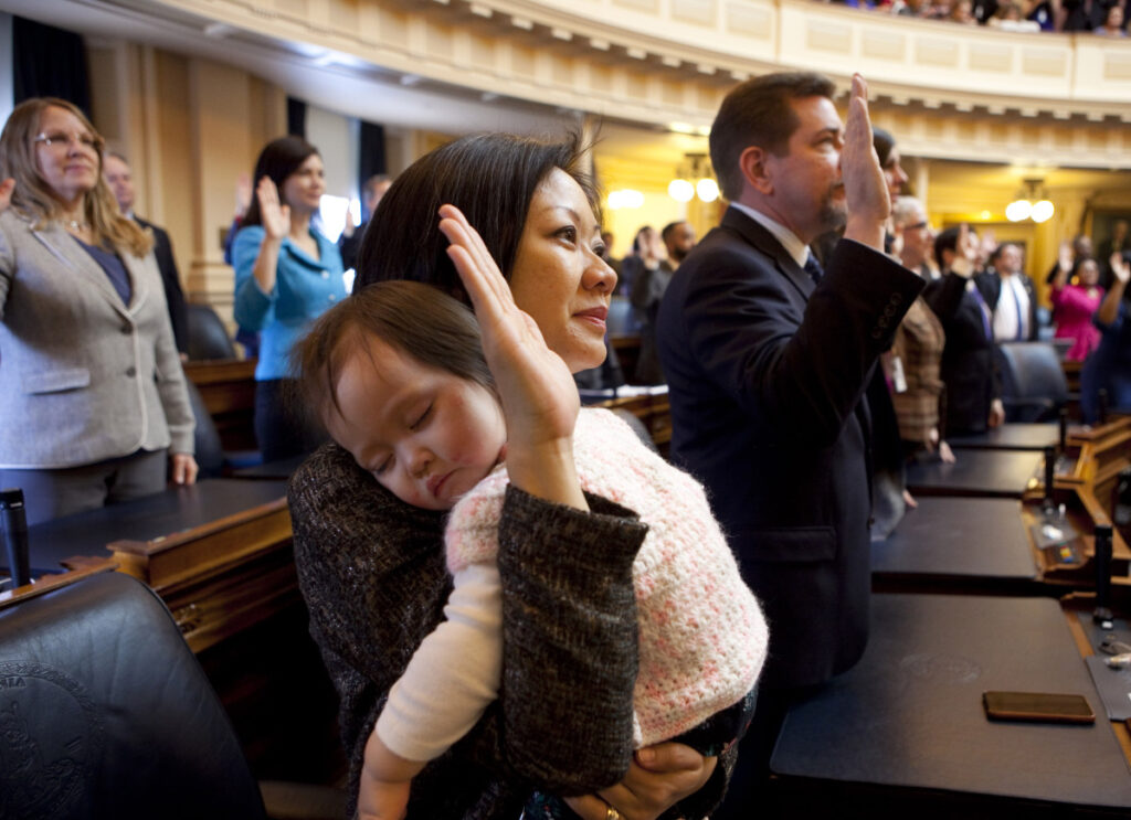 Virginia Del. Kathy Tran, with her daughter Elise at her swearing-in, says she misspoke about an abortion bill.