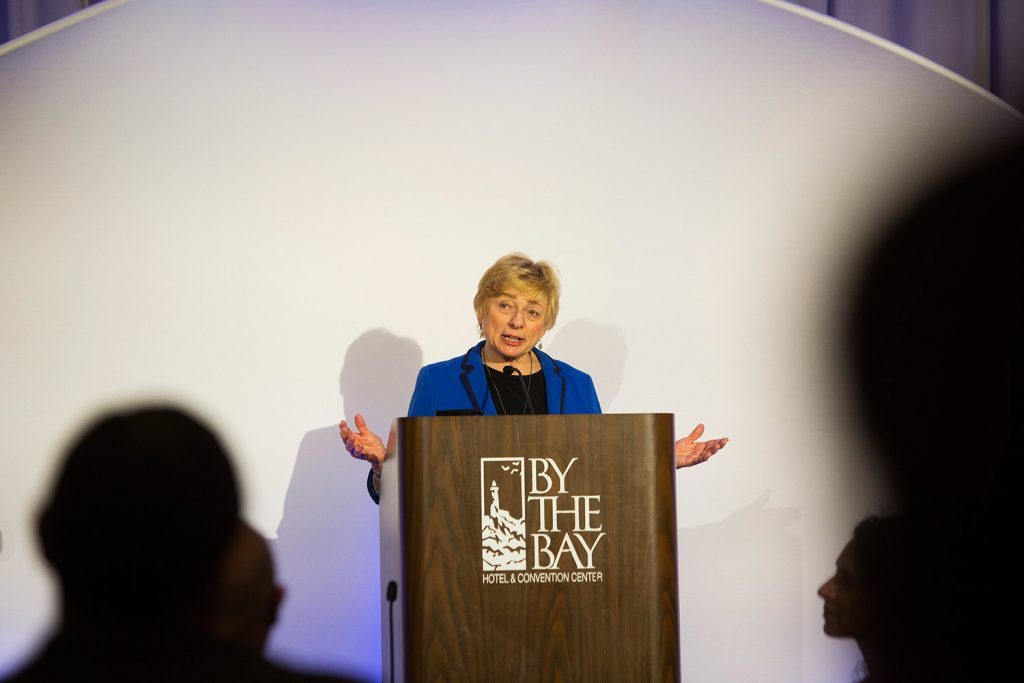 "Gov. Janet Mills speaks at the Portland's Martin Luther King celebration Monday night. She called on the audience to work to raise up all people, especially people ""from away."""