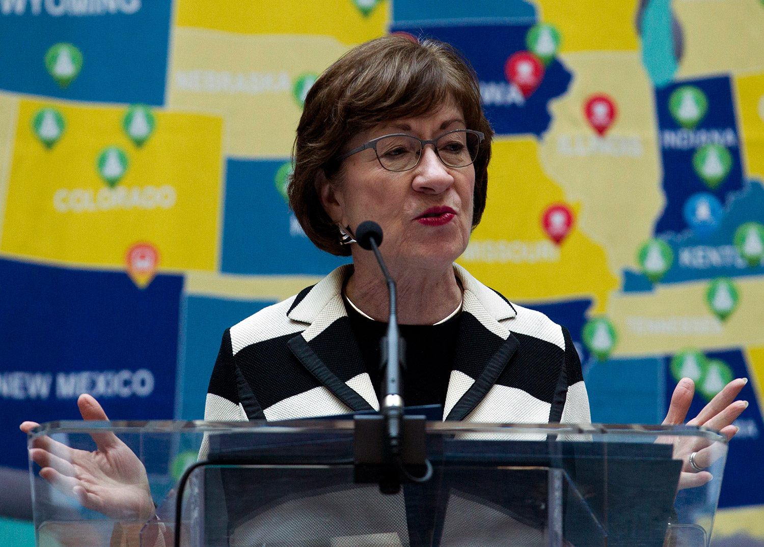 Sen. Susan Collins, R-Maine, shown last month in Washington at an announcement related to infrastructure investment, says she would support bills to fund the government that do not include money for a border wall, and consider border security separately.