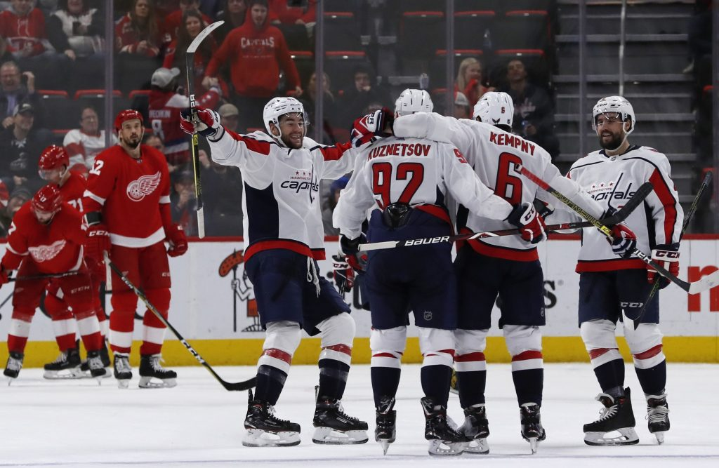 Washington celebrate after scoring a goal during a 3-2 win over the Detroit Red Wings on Sunday in Detroit.