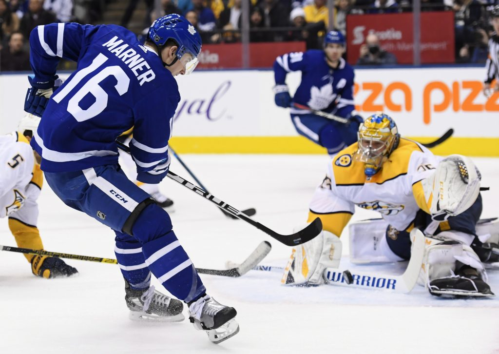 Toronto Maple Leafs right wing Mitchell Marner (16) shoots against Nashville Predators goaltender Pekka Rinne (35) during second-period Monday in Toronto.
