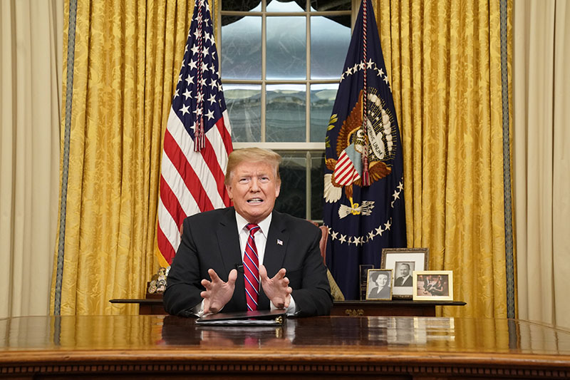 Donald Trump speaks from the Oval Office on Tuesday.