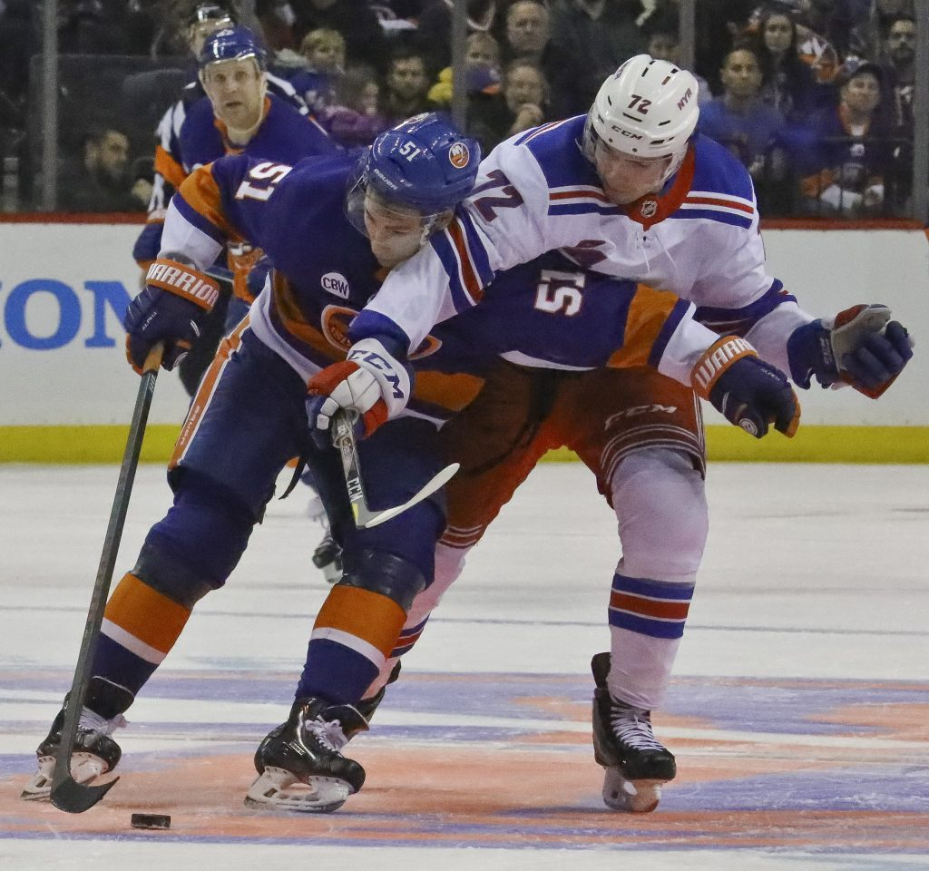 New York Islanders' Valtteri Filppula, left, shields the puck from New York Rangers' Filip Chytil during the Rangers' 2-1 win Saturday at Barclays Center in New York.