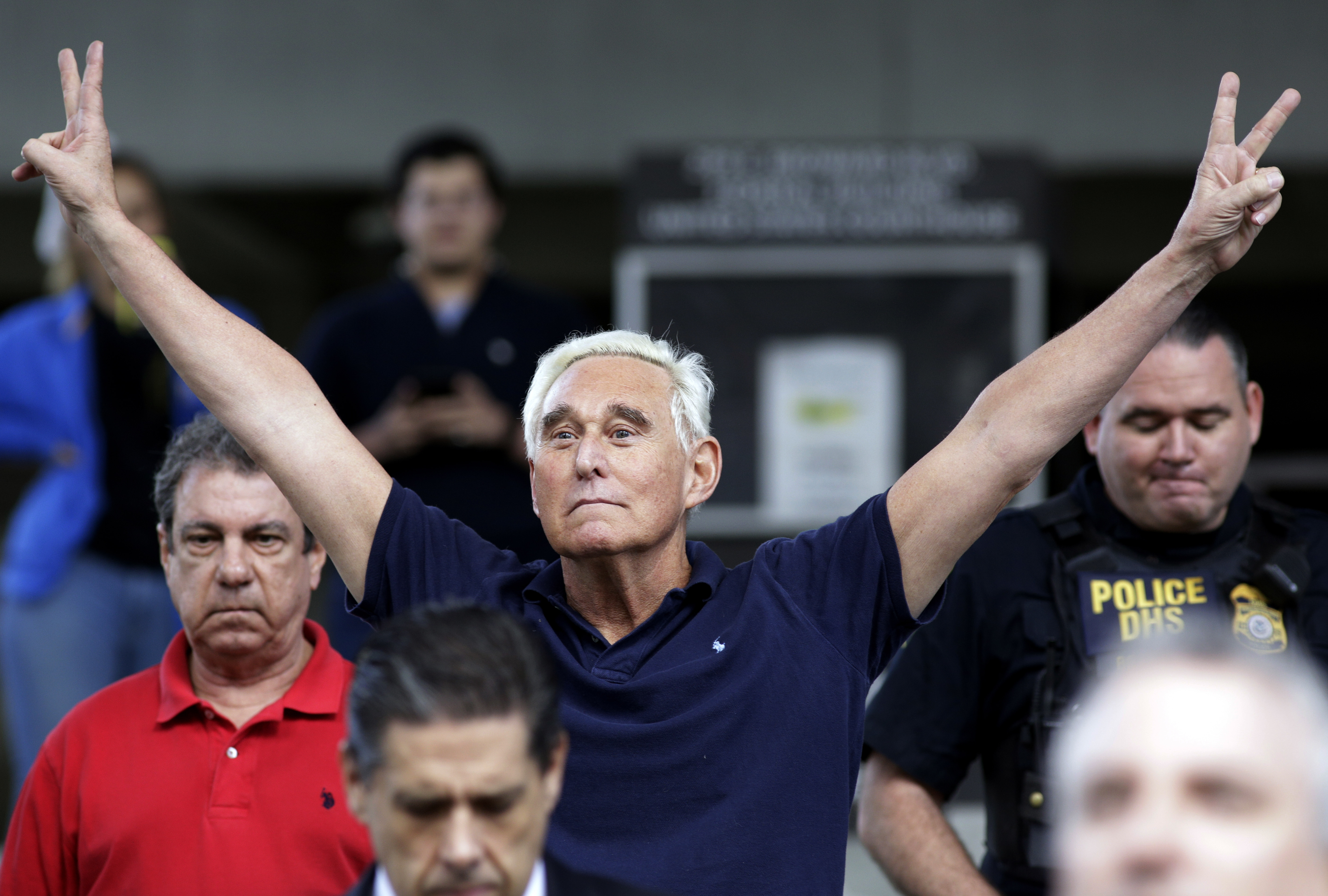 Roger Stone, 2016 campaign adviser for President Trump, walks out of the federal courthouse after his hearing Friday in Fort Lauderdale, Fla. Stone was arrested Friday in the special counsel's Russia investigation, charged with lying to Congress and obstructing the probe.