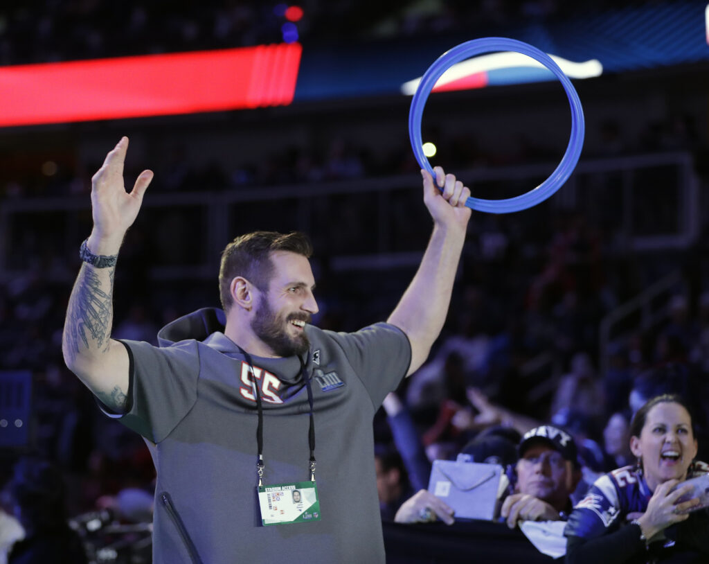 New England Patriots' John Simon plays a game during the first night of Super Bowl festivities on Monday in Atlanta.