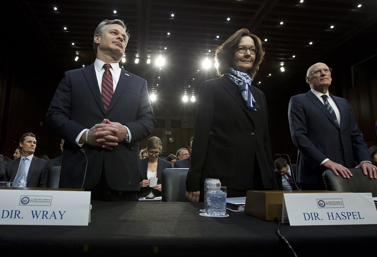 From left, FBI Director Christopher Wray, CIA Director Gina Haspel and Director of National Intelligence Daniel Coats arrive to testify before the Senate Intelligence Committee on Tuesday.