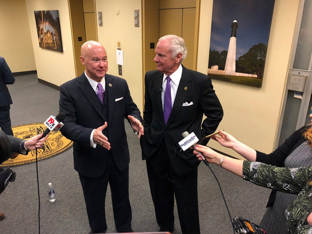 Chairman Tom Mullikin, left, of the South Carolina Floodwater Commission, speaks with South Carolina Gov. Henry McMaster about the goals of the new panel on Dec. 20, 2018, in Columbia, South Carolina. Mullikin is that rare conservative who knows that climate change is real and that human contribution is part of it, writes columnist Kathleen Parker.