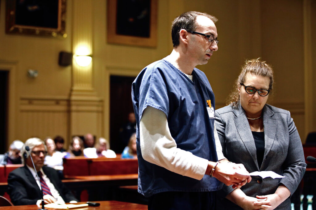 Derek Boyce, a former teacher, reads a statement after pleading guilty to several counts of sexual misconduct with a 15-year-old student, in Androscoggin County Superior Court in Auburn on Wednesday. At right is his lawyer Heidi Pushard.