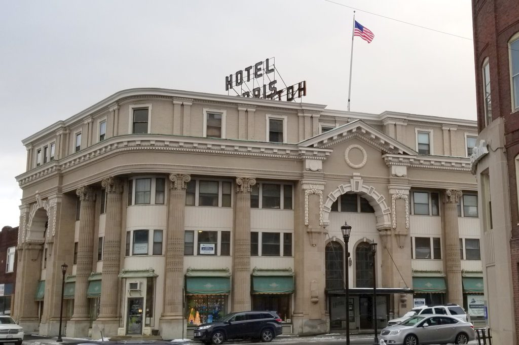 The Hotel Harris building, from Congress Street. The signs in the second-floor windows are in two of the three rooms offered to guests in the building, according to owner Jim Adinolfi.