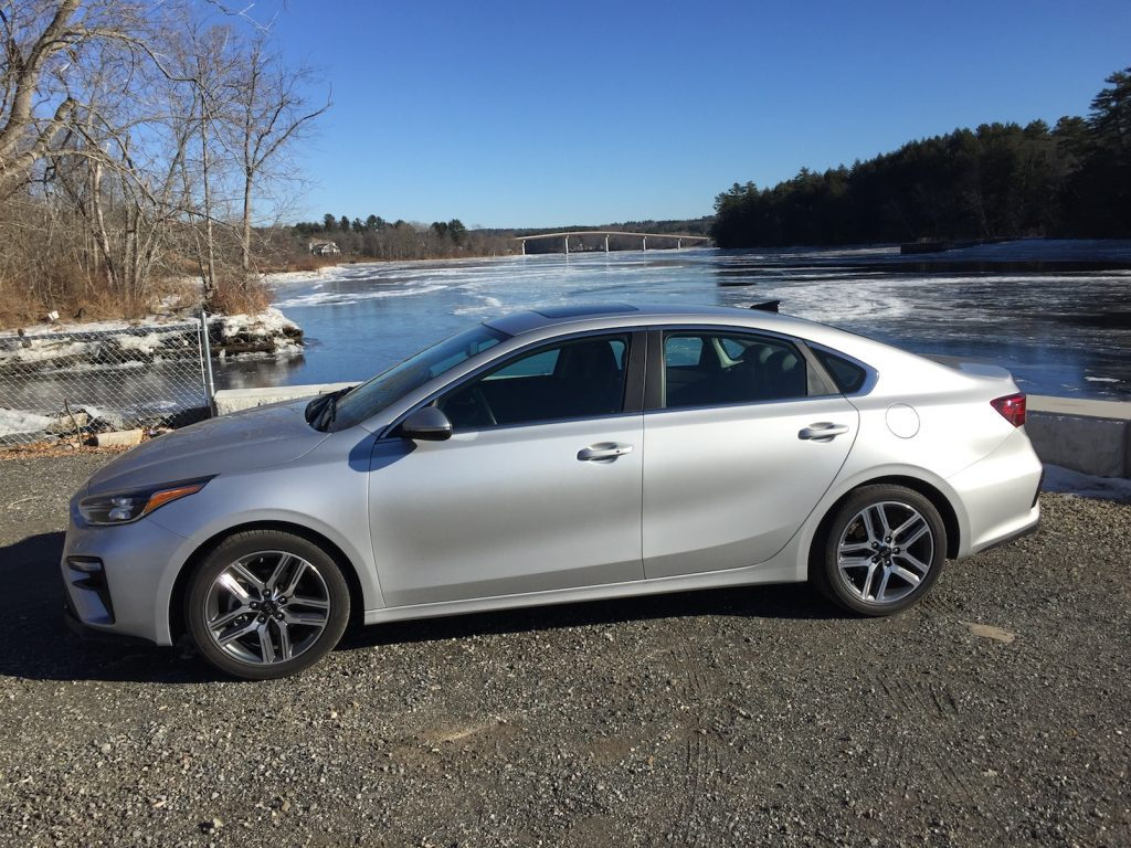 "The latest Kia Forte, ""a stylish, handsome four-door ... larger, more comfortable, and more capable than its predecessor."" (Photo by Tim Plouff, by the Kennebec River in Richmond.)"