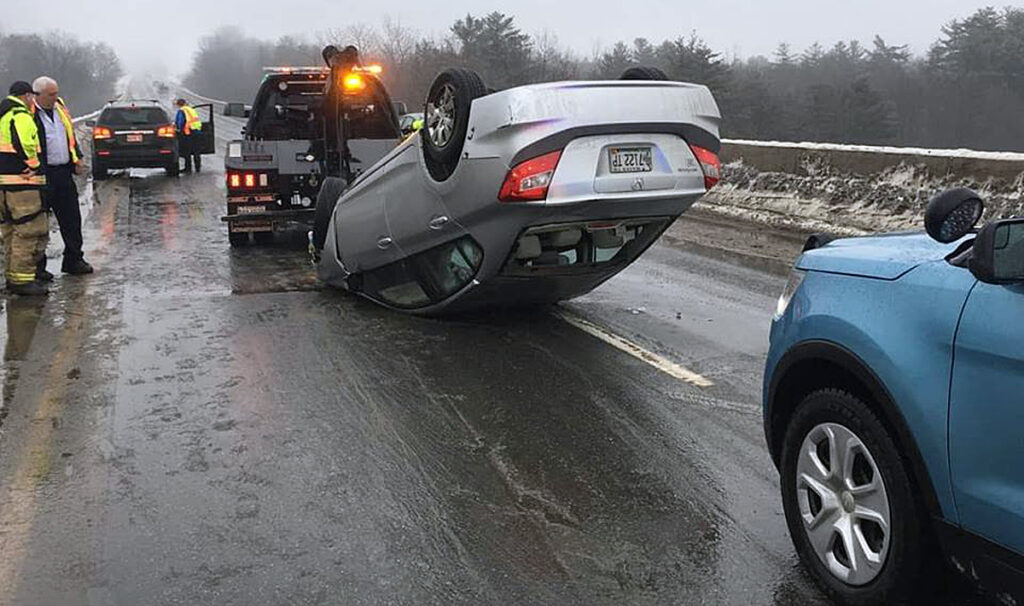 A driver headed north about 7:30 a.m. Thursday near mile marker 130 lost control on ice on bridge, hit both sides of concrete barriers lining a bridge and flipped over.
