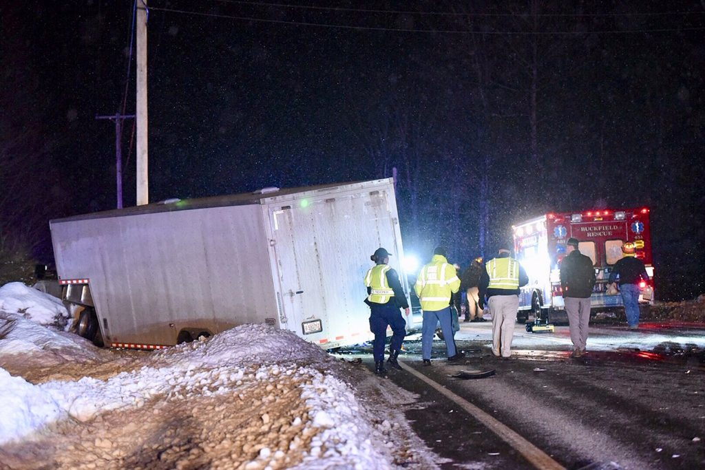 A collision between a Volkswagen Beetle and a pickup truck killed one person and shut down Route 117 in Buckfield on Wednesday night.