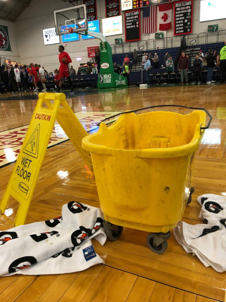 A bucket collects water dripping from the leaky roof at the Portland Expo, where Thursday night's basketball game between the Maine Red Claws and Grand Rapids had to be postponed.