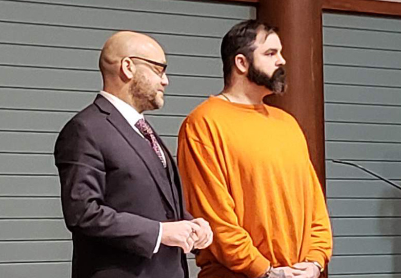 Joshua Vandine stands next to his attorney David Sinclair in court on Friday.
