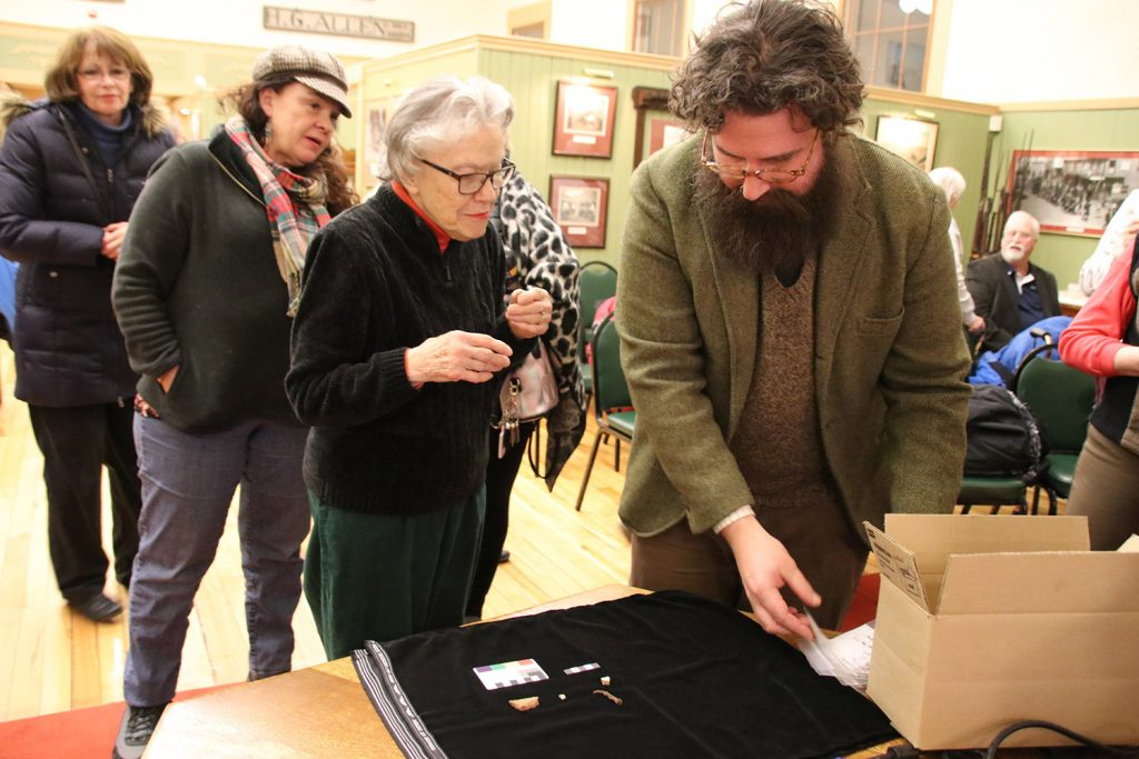 Terry Parsons chats with University of New England professor Arthur Anderson about artifacts found last summer in an archaeological dig in Sanford during a presentation Thursday at the Sanford Springvale Historical Museum. Those who conducted the dig hoped to find  evidence of the 1740s Phillipstown garrison.
