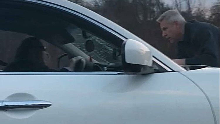 Video shows two men who allegedly got into a road rage incident  in which one drove at speeds of up to 70 mph with the other clinging to the hood of his vehicle