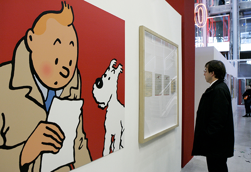 A visitor looks at original letters and an enlarged cartoon of Tintin by Belgian cartoonist Herge at Paris' Pompidou Cultural Center in 2006.