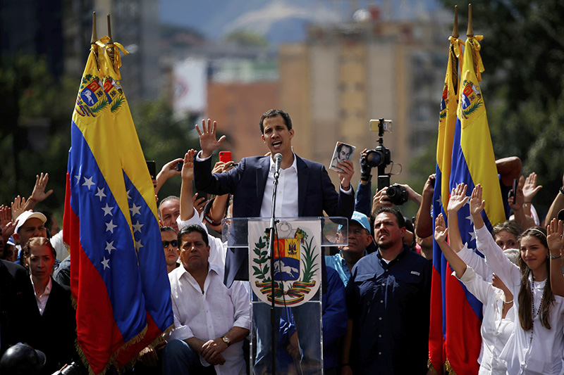 Juan Guaido, head of Venezuela's opposition-run congress, declares himself interim president of Venezuela, during a rally demanding President Nicolas Maduro's resignation in Caracas on Wednesday.